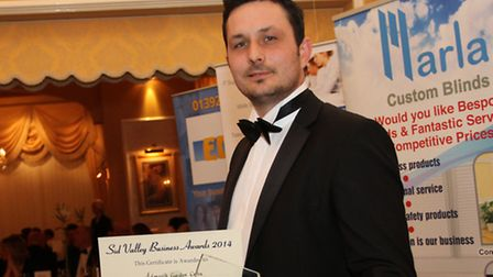 Garden centre manager James Trevett claiming the customer service award at the first Sidmouth Busine