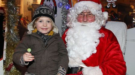 Sidmouth late night shopping. William Beach says hello to the Lions Club Santa. Ref shs 2253-50-14AW