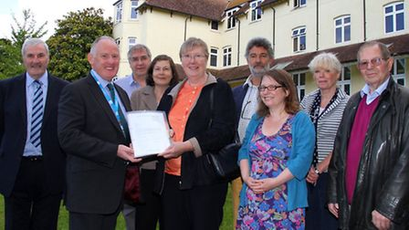 Margaret Hall of the West Hill Campaign Group handed a petition over to Mark Williams, Chief Executi
