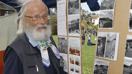 Kingsley Squire looking at old photographs of Sidmouth at the Sidmouth Seafest in 2014. Ref shs 4136