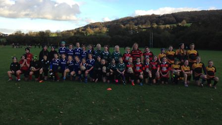 Sidmouth Under-13 girls with the other teams who took part in the club's Under-13 girl's meeting