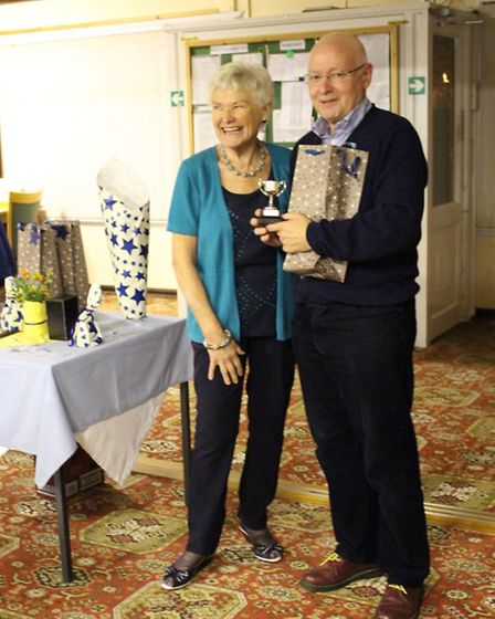 Ann England presents Allan Davis with the trophy for winning the Sunset Umbrella competition.