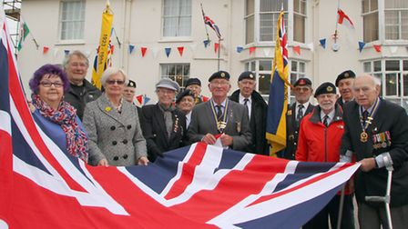 Sidmouth Royal British Legion raised the Union Jack which was donated to Sidmouth Conservative Club.