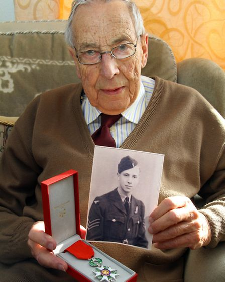 Fred Danckwardt receives an award in recognition of his service during World War II. Fred with a pic