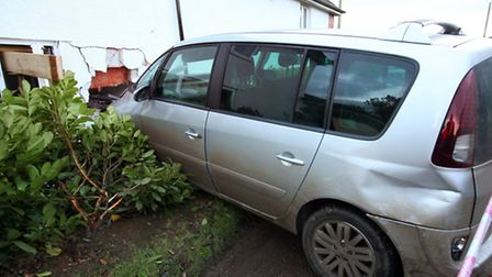 A car crashed into the side of a house in Fluxton, near Ottery St Mary. Photo by: APEX NEWS AND PICT