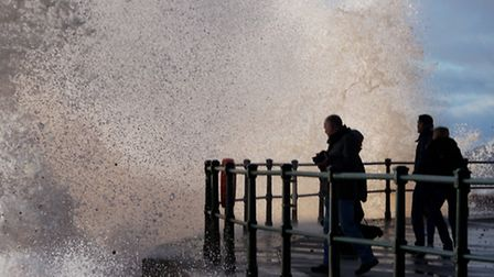 A huge wave crashes into the promenade. Picture: Eve Mathews.