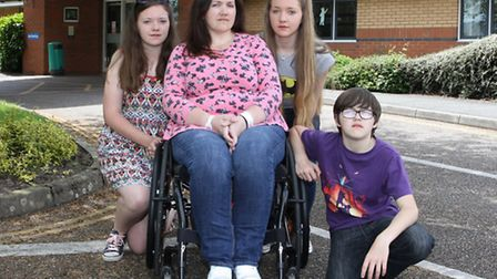 Lucy Lowe with her children Lydia, Tilly and Barnaby outside Ottery St Mary Hospital. Ref sho 8187-2