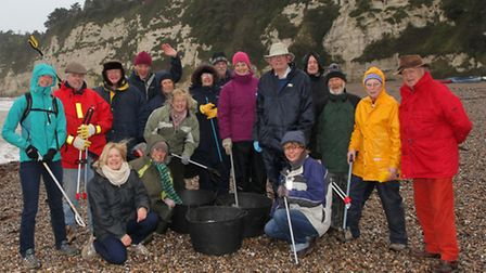Volunteers gathered on a very blustery Beer beach on New Year's Day morning to help clear the beach