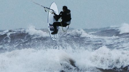 A kite surfer braves the waves duting the Christmas break. Picture: Eve Mathews