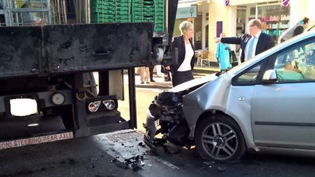 A Ford Focus collided with a supermarket lorry