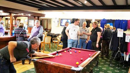 Paul Tallon plays pool at Sidmouth Golf Club during the Indoor Sports Night at the club