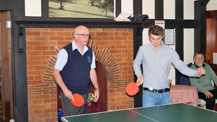 Sidmouth Golf Club captain John Barnard and James Winchester showing great table tennis talent altho