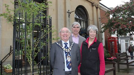 Diana East and John Dyson mark a tree planting with former town council chairman John Hollick last y