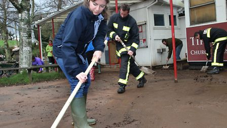 Counciloor Claire Wright donned her wellies and helped cleaning the playground at Tipton primary sch
