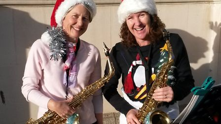Jan McCann and Jackie Ensall played Christmas songs in the streets of Sidmouth and raised more than