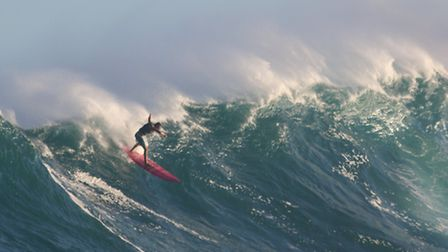 Adam Amin surfing Jaws, in Hawaii. Picture: Glenn Tremble.