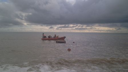 An old photograph of two lifeboatmen from Beer Coastguard.