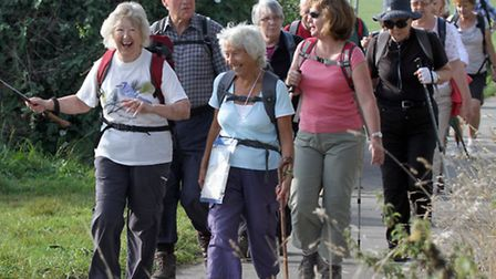 Walkers set off for their final trek of the Sidmouth Walking Festival. Ref shs 6125-40-14AW. Picture