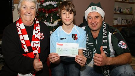 Plymouth City supporter, Kym White, and his son Jake who supports Exeter City presents Di Lee from t