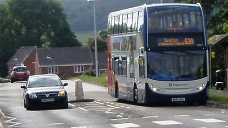 A car overtakes a bus in Stowford Rise