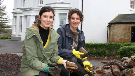 Emma Mollony, project coordinator, and Anna Wardrop, garden designer, make use of the old cobble sto