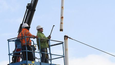 The top section of the flagpole is lifted off. Ref shs 08-16SH 5604. Picture: Simon Horn