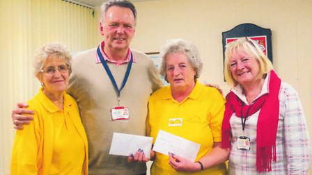 Dream-A-Way chairman Jeff Merrit MBE and trustee Gill receiving a cheque from Eve Lankester (left) a