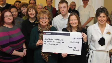 Rachel Johnstone and Angela Thompson from the Memory Cafe receive a cheque from staff at Fields for