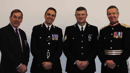 Sgt Andy Squires (mid right) with Devon and Cornwall police and crime commissioner Tony Hogg, Chief