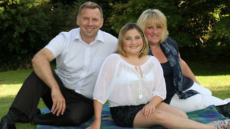 Fifteen year old Charlotte Reid with her parents Steve and Angela this week. Ref shs 7730-34-15SH. P