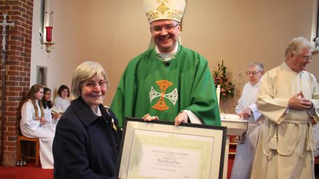 Norma Hoare receives The Benemeienti Medal from The Bishop of Plymouth on behalf of the pope. Ref sh