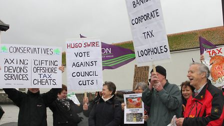 A group protesting against big buisness coporate tax avoidance gathered outside the Sidmouth Conserv