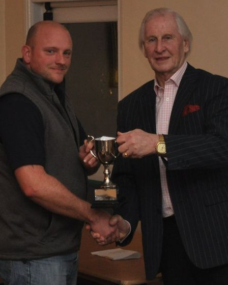 Andrew Lapping receives the D Division East 2nd XI cup from Devon League chairman Stuart Munday