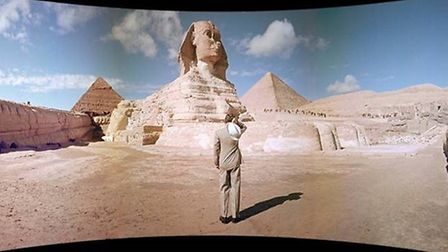 A scene from Seven Wonders of the World. Lowell Thomas in the foreground.