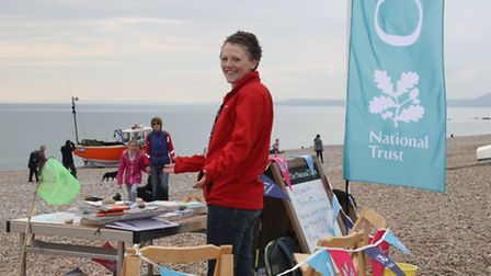 Volunteer Georgie Goddard on Branscombe Beach at the weekend.