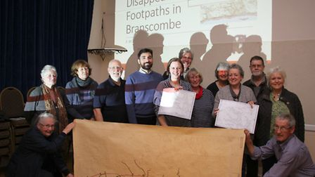 Emma Rouse from Wyvern Heritage with Dr Stelios Lekakis and Branscombe residents at the village hall