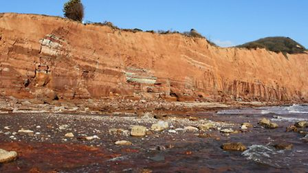 East of the River Sid the battered cliffs and its beach littered with rocks at low tide this week. R