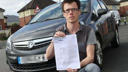 Manstone Avenue resident Tim Hammond with the parking notice he received at the RD and E. Ref shs 11
