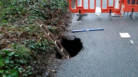 sho West Hill Road is due to reopen soon after work to repair giant hole commenced this week