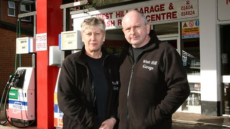 Debra and Gary Tennant from West Hill Garage are pleased work has started ready to re-open the road