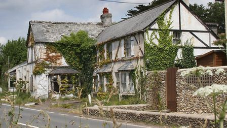 Once a popular pub and restaurant, the Three Horshoes on the A3052 now lies derelict and the land fo