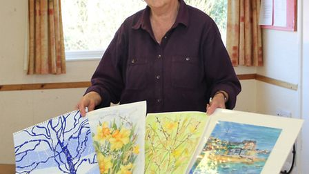 Trudi Longmire is pictured with a small section of the art produced by the 'In the Picture' group fo