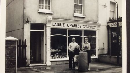 Vicki Marshall with her parents outside their Temple Street shop
