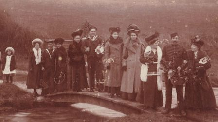 A photograph of some of the Branscombe coastguards and their wives on a rare occassion where they co