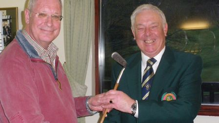 Sidmouth club captain Ray Gunston cannot keep the smile of his face as he is presented with the JH T