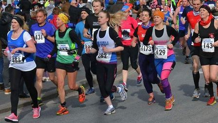 Sidmouth runner Becky Robson (third from left in green top) competing in the Bideford Half Marathon.