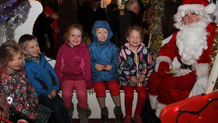 Children meet Santa at Sidmouth late night shopping. Ref shs 7703-50-15TI. Picture: Terry Ife