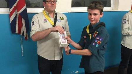 Ottery scout Aidan Pearcy receives his prize from scout leader Chris Evans for winning third place i