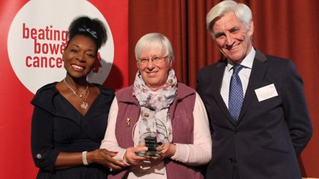 Mary Bray (centre) was presented with a national award for her work with Beating Bowel Cancer