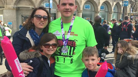 Giles with his family after completing the Sheffield half marathon.